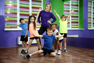 Dance teacher and children in choreography class
