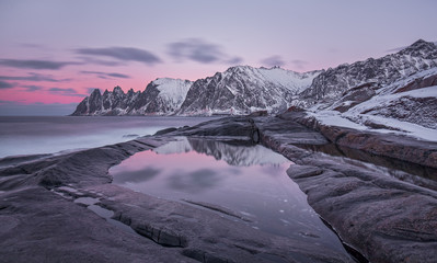 Winter panoramic view to Steinfjord on Senja island at sunset - Troms county, Norway (long exposure).
