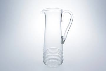 Crystal glass transparent decanter on gray background