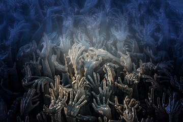 Hands reach up from the underworld.