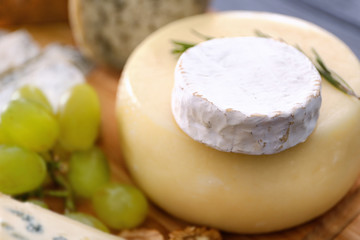 Cheese heads with grape, close up