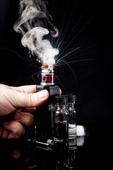 Electronic cigarette with 2 bottles and cloud of smoke