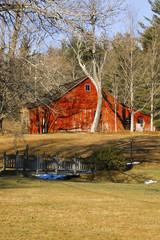 Old weathered barn on a farmland.