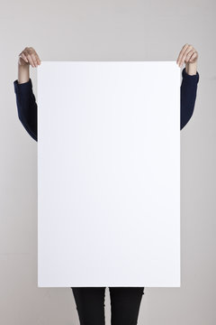 woman hand hold a blank poster