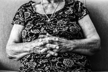 Old Woman Is Sitting With Keeping Hands Together