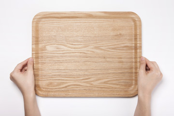 woman hand hold a wood tray isolated white.