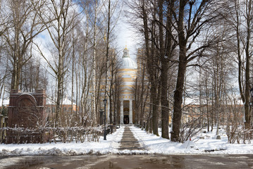 Alley to the Trinity Cathedral in April afternoon. The Alexander Nevsky Lavra, St. Petersburg. Russia