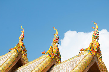 Dragon statue on roof.