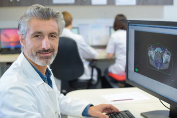 Portrait of male healthworker using computer