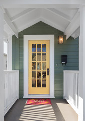 House entrance with yellow glass door