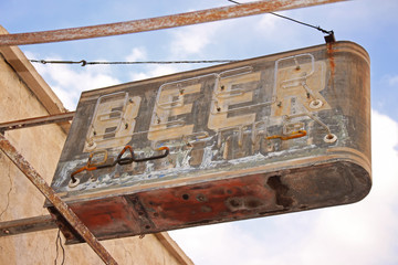 A beer sign marks the location of a long abandoned bar in the American Southwest.