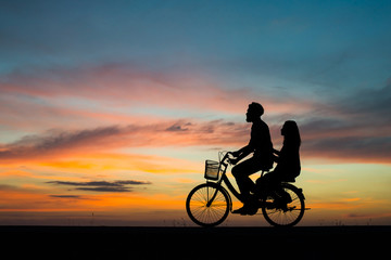 Silhouette young couple in love enjoy good time together during sunset.