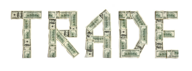 "Word ""TRADE"" made of dollars. Photography of money made word - on white background. Top view. High resolution product"