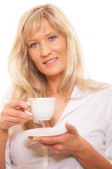 Mature woman drinking tea or coffee..