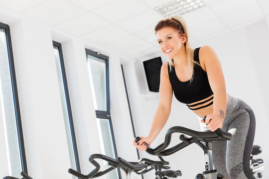 Attractive young woman during spinning class.