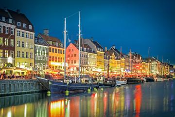 Famous old Nyhavn harbour at night in Copenhagen, Denmark