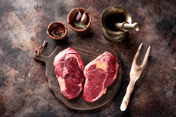 Wall Mural - Raw fresh meat Ribeye Steak heart shape, spices and mortar