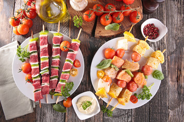 raw beef and fish for barbecue
