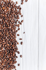 coffee beans on a white wooden background