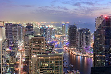 Scenic view from roof top of Dubai's Jumairah Lakes Towers (JLT) by night