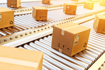 Packages delivery, packaging service and parcels transportation system concept, cardboard boxes on conveyor belt in warehouse