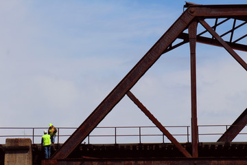 Workers on a bridge