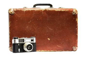 Old vintage suitcase and old camera on a white background.