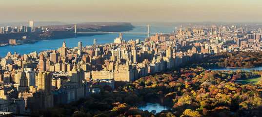 Panoramic elevated view of Central Park, Upper West Side and the George Washington Bridge with Hudson River in Fall. Manhattan, New York CIty