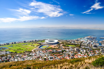 Beautiful view of Mouille Point, Green Point with Cape Town Stadium and the V&A (Victoria and Alfred) Waterfront in Cape Town seen from Signal Hill. Sunny day with a few clouds. South Africa.