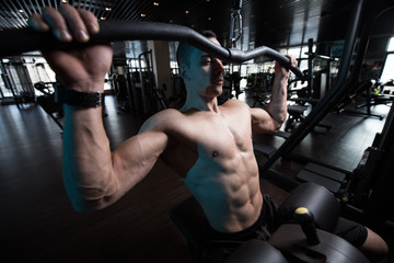 Athlete Doing Heavy Weight Exercise For Back