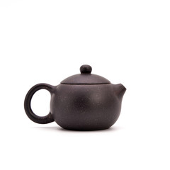 Retro clay Chinese teapot isolated on a white background. small earthenware