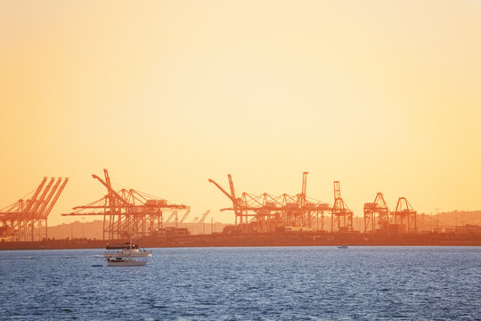 Long Beach shipping port with cranes at sunset