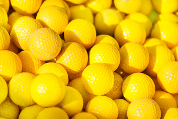 Close-up picture of yellow golf balls pile