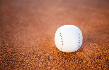 Baseball ball on playing field, copy space