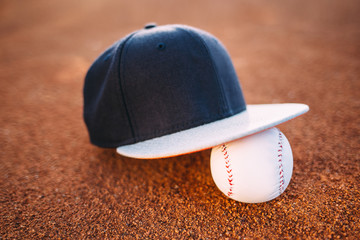 Baseball cap and ball