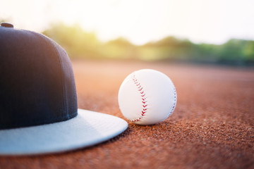 Close up of baseball cap and ball