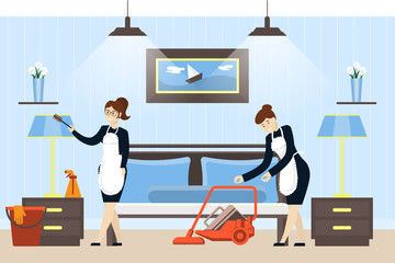 Hotel room cleaning service. Maids in unifrom clean the rom.
