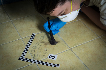 Forensic experts  found traces of the tread of shoes on the tiles in the bathroom