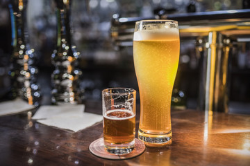 Beer glasses with beer on the bar 4