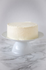 Whole White wedding or Birthday sugar free and gluten free Cake on marble background. Vegan food concept