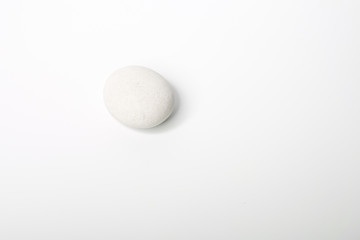 White stone of a round form are isolated on a white background