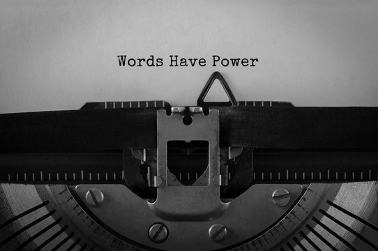 Text Words Have Power typed on retro typewriter
