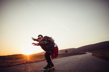 Young skater riding a skateboard outdoors on the street alone
