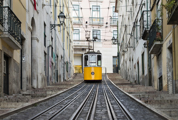railway and lonely yellow tram in Lisbon in Portugal