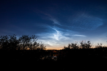 Noctilucent clouds at night sky