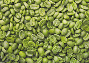Green coffee beans background.