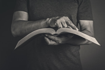 Men reading the Holy Bible