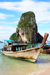 longtail boat on railay beach, krabi, thailand