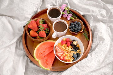 Breakfast in bed. Healthy food and coffee on tray