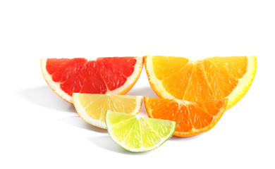 Delicious citrus fruits slices on white background